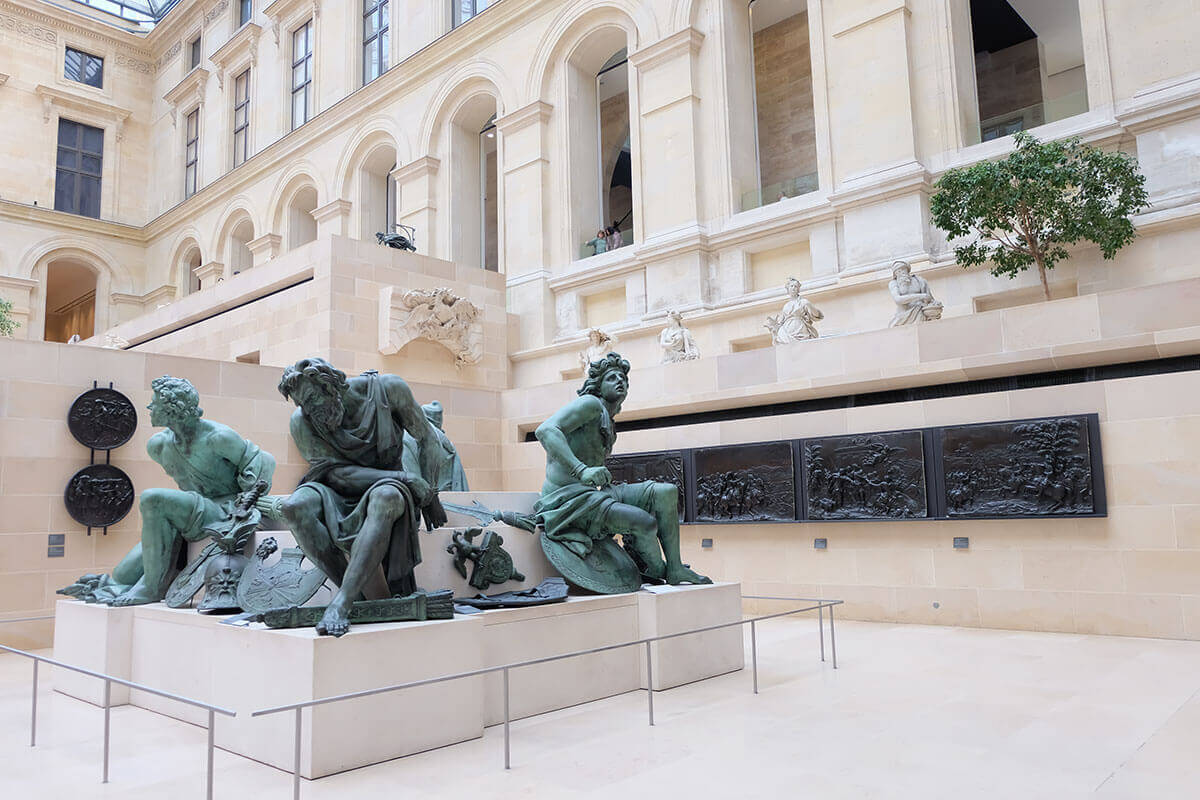 Sculptures in the holl Louvre, Paris